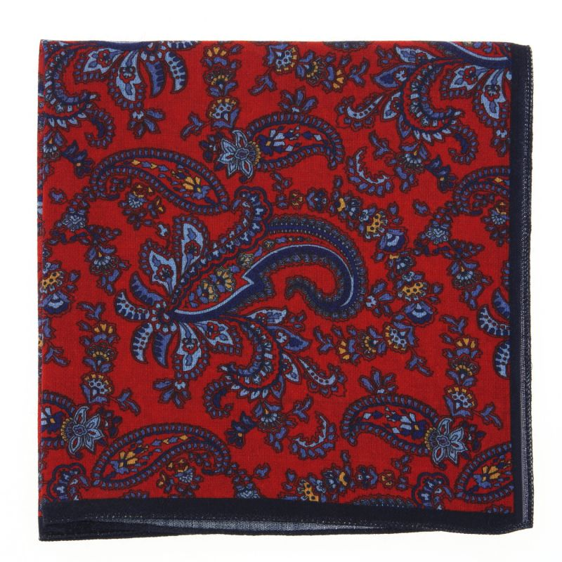Red pocket square with blue and yellow paisley design The Nines