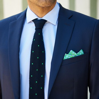 Navy blue knit tie with green polka dots