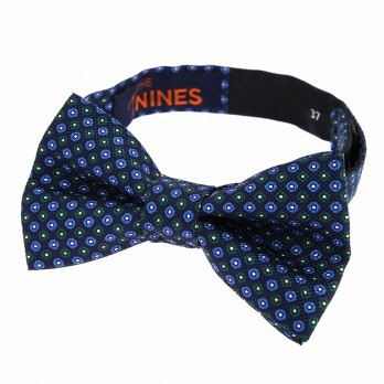 Navy blue bow tie with green dots